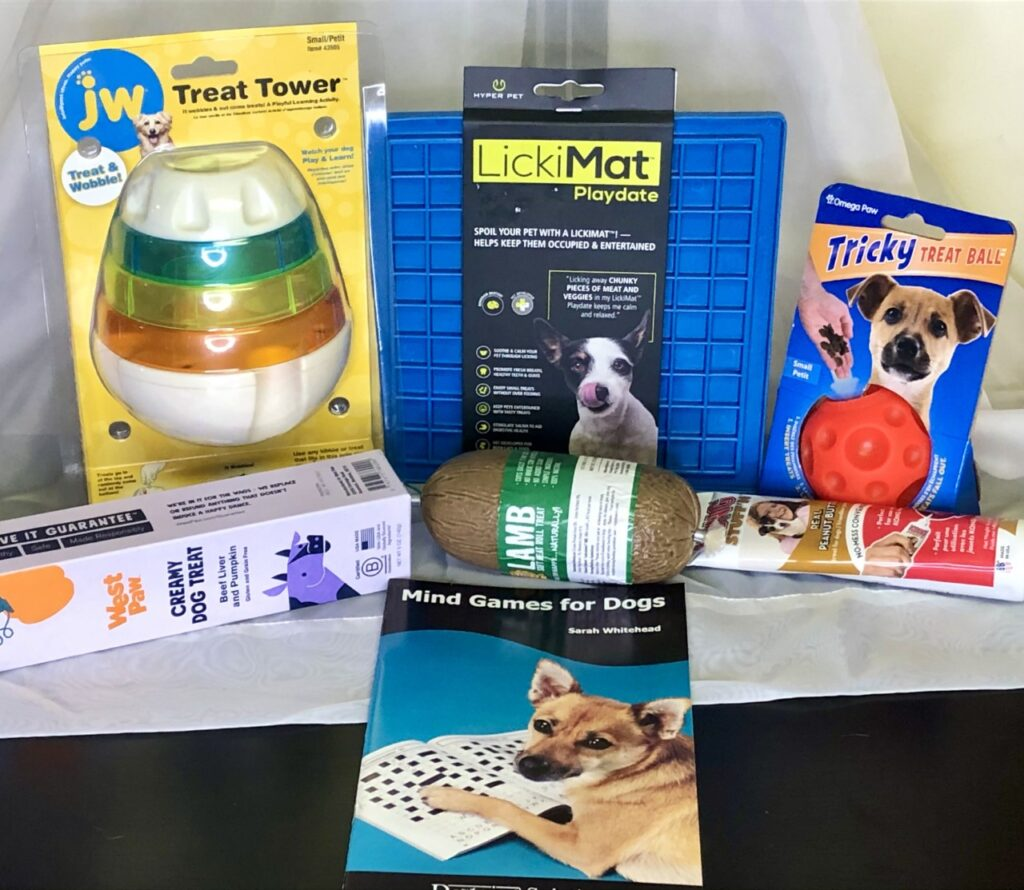 Medium Enrichment Gift Set $50 +tax: Treat Tower, Lickimat, Omega Treat Ball, Happy Howie's Lamb Treats, West Paw Beef Paste Tube, Kong Peanut Butter Tube, Mind Games for Dogs Booklet